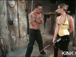 Domination tart drills a stud with a strap-on