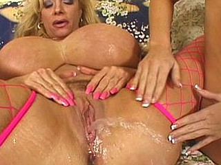 Giant titted squirter opens her legs wide to gush as far as that honey can discharge