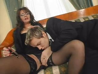 Busty brunette MILF eats his cock and then gets screwed hard
