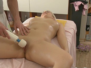 Blonde is massaged with a huge ball sex-toy