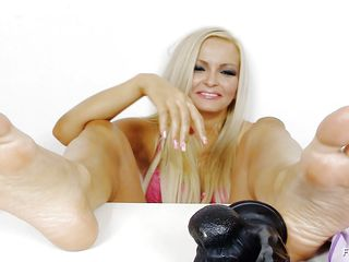 hot blonde pleasuring sex toy with her feet