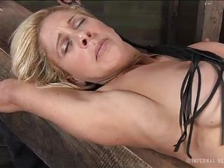 blonde beauty between enjoyment and pain