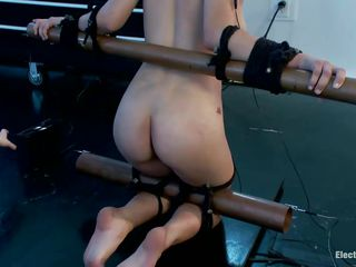 Watch this hawt babe Raven Rockette with big tits being punished for all her sins. Her body is fastened up into a bondage device and this babe has electrodes on her triceps and a ball gag on her mouth. Charming blonde femdom-goddess Aiden Starr is there to enhance the pleasure, using a long electric wand that this babe has.