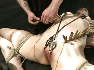 Katharine Cane is a busty brunette hair milf desperately in need for punishment. See how Soma Snakeoil and her male ally give her what that babe wants. The hot red haired babe and her help are putting clothespins all over her body, making her shriek with pleasure and ache while rubbing her pussy with a big vibrator.