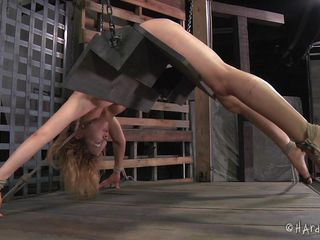 This is something very nice. The hawt blonde Rain is tied on specially designed platform that keeps her bent over with her ass up. Her executor uses metal clamps to widen her fragile muff lips and suggests us a great view of her cunt. Rain is experiences more humiliation that she ever could it's possible, and likes it!