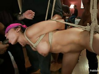 tied up brown hair gets her attractive mouth fucked