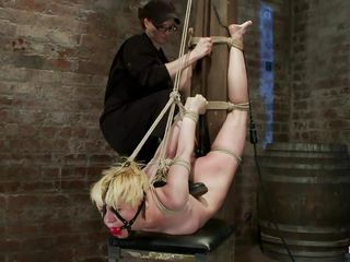 bound golden-haired receives a spank on her a-hole