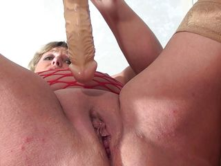 obese blonde mature enjoys a dildo and a cock