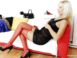 This blond slut wearing red pantyhose is sitting on the sofa with a horny male. They begin touching and playing each other body, so the stud takes off her small panties and begin to lick her pussy. During the time that this guy licking the bawdy cleft this guy find inside another couple of pantyhose and takes it out from there.