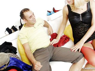 This blonde whore wearing red hose is sitting on the daybed with a horny male. They begin touching and playing each other body, so the guy takes off her small pants and begin to lick her pussy. While he licking the vagina he discover inside another pair of hose and takes it out from there.