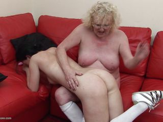 This granny has the younger woman on her knee, but if u are thinking that this babe is going to lack any sexuality, You have to think again as this babe lures the younger woman between her legs and spreads her big legs wide open for younger woman. Apparently the black haired woman likes what this babe finds there.