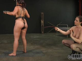 Dana is a dirty slut and deserves what's happening to her. They've tied her on that chair and secured her body in bondage devices. Now that she's immobilized a mistress plays with her shaved pussy and taunts the whore before things will get actually coarse for her. Relax and enjoy what they do to this cheap bitch