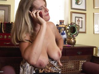 Daphne, a hot 44 years old milf is talking on the phone and that babe decides to masturbate. This babe can't wait any longer and talking to the phone is just making her more horny so that babe starts fingering her pussy. Even that babe is a mature women that babe enjoys playing with herself. Do you think that babe will reach orgasm?