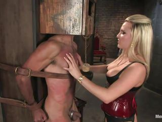 Dominatrix Harmony doesn't allows men to do what they want, so, with the help of her chains and all sorts of simple but efficient tools she punishes this muscled guy, first by adding clothespins on his face and then by drubbing him whilst he's in chains. She does her job perfectly and soon this man will be obedient enough
