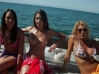 Amber Sym and Megan Curry chill on the boat with other sexy women. They show off their beautiful bodies and go scuba diving while enjoying the amazing weather on the coast, all while frolicking in the nude.