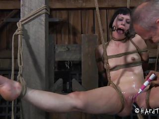 Katharine has a pair of gorgeous haunches and the executor knows to take the best out of them as he tied the doxy and spread her legs wide. He opens her throat and used a dildo to fuck her shaved pussy and that pretty mouth. Damn this babe looks good in that position with her delicious vagina on full display.