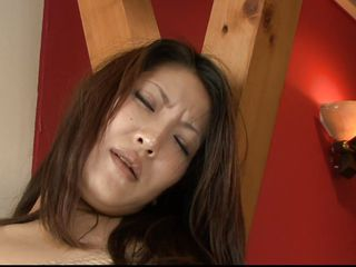 Saya is wrapped in rope so this babe can't go anywhere. She pushed to the floor and has a large dildo shoved up her beautiful, hairy Japanese pussy. She moans in pang and pleasure as her man shoves the dildo deep inside her