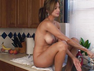 She's the kind of mom that likes playing with food and when this beauty feels horny she gets dirty! Look at her pretty smile and that beautiful body, her breasts are big and round and she pours syrup on them! It seems that mommy needs a fuck, a very dirty, hard fuck right there in the kitchen!