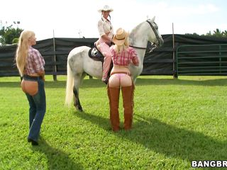 3 cowgirls are alone and they have some naughty toughs in their perverted minds. They all start to get wet. I want some real action and I'm sure you want it also but you got to wait a little. Lastly they sit down on the grass and a golden-haired chick shows off her ass. Keeps me wonder whats next.