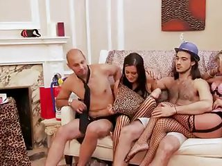 These blonde and black haired women are with those 2 guys and looks like they are playing some kind of joy games. But soon they start to have some raunchy fun! Right after that, they all get into the bathroom and both of those 2 horny women start sucking one of the guy's cock!