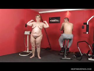 plump mature lady and trainer humping in the gym