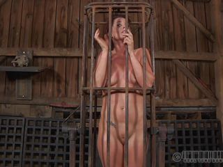 A metal cage and a harsh mistress is all that this cunt needs to be disciplined. Stick around and enjoy how the mistress plays with this bare gal and how compliant she will become. Every naughty bitch merits a treatment like this!