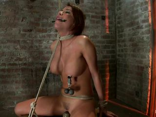 Watch this sexy whore, her name is Aleska and these couple of perfect wobblers surely got your attention and her executor's too. That babe has clamps with weights on her hard nipps and is tied up hard and suffocated not fast as the rope around her neck doesn't gets looser. Aleska stays there, immobilized in that position and endures her torture moaning as a vibrator is placed right between her sexy widen legs, on her pussy.