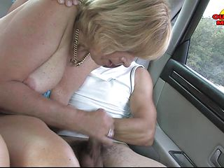 blond aged lady getting double blowjob
