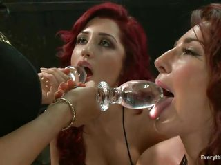 These two redheads have big round butts and guy the harlots love it anal. They've bent over and and got their tight ass holes filled with these glass anal plugs, look how nicely it slides inside these bubble butts. It makes your cock hard merely looking at such oiled asses, not to mention seeing them penetrated!