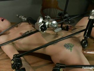 Hot blonde slut Chastity is all tied up on a table and gets her cunt fucked by a dildo machine. This babe has a dildo attached to her clitoris, so that that babe could cum very easily. The speed is increasing and the slut feels more excellent and better. Wanna watch this whore cumming and moaning with pleasure?