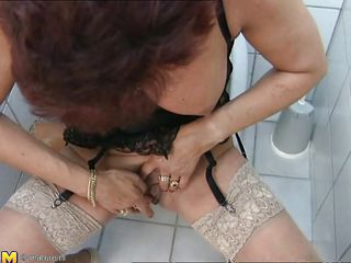 The act takes place is a public restroom where a short hair aged woman with a small pair of tits begins rubbing herself in all kind of positions. Although that babe pass her youth for a time, her shaved pussy is in a great shape and it's getting wetter with each finger that babe feels
