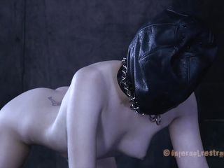 The leather bag is removed from her head and that's the beginning of Alani's sexual punishment. Her mouth is covered with a belt on mask and then a metal hook is inserted deeply in that tight, appealing anus. After the hook is removed she receives a mean dildo fucking and a lot more. Damn slut enjoys it too!