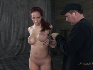 Kelly has nice form and big soft boobs. Those breasts are tied with rope and squeezed actually really hard making the redhead whore horny. She kneels like an obedient sex slave and willingly swallows the guy's lengthy hard penis. Does that babe swallows ball cream the same way that babe does with cock or that babe prefers it on her breasts?