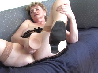 This old women appears to be to be very lewd because that babe is touching large hairy snatch and that babe rubs her big boobs. She is sitting on the bed and that babe takes a thick dildo and starts suck him imagining that is a big cock. After that that babe starts to masturbate with it very deep and slow moaning of pleasure.