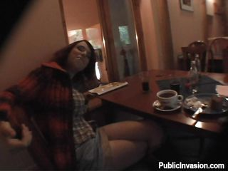 horny dark brown chick in a restaurant