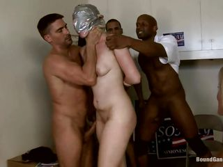 Group of men wish to chastise this hot blonde chick for ignoring their advances, so they take her to an apartment. They ball gag her and tie her head so that they can fuck her tight pussy hard. She acquires a mouthful and acquires all her holes filled by their big cocks.