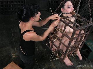 That's what this babe merits for being a fucking whore. Brunette milf Dixon is now in a small bondage cage and her female-dominator shows her no mercy as this babe uses her devilish skills to torment her. Dixon is in pang but this babe will have to endure a lot more. Curious what? The watch some more and delight yourself!