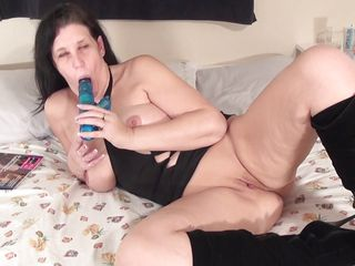 sweet older satisfying her with a huge dildo.