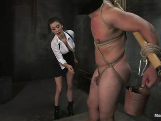 Orlando is tied up, taking Princess Donna's torture with gratitude. This babe puts clothespins on his balls, then whacks him in the nuts with some spanking toy. Next that babe has a fucking machine hanging from his nipples and sack, tied to his legs. This babe makes him position himself so that babe can get pleasure.