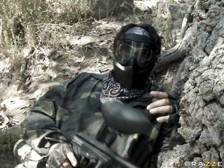 hot brunette playing paintball in advance of some hot action