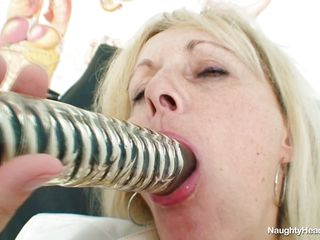This hot mature blonde bitch is naked and this babe is playing very gentile with her large vagina. This babe now is licking and sucking a very large and thick dildo. This babe become concupiscent and horny and this babe introduce this dildo sluggishly in her pussy. Surely this babe will have an intensive and great orgasm.