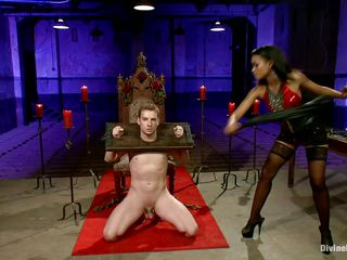 Queen Skin Diamond bound Sebastian Keys with fetters. The swarthy goddess whips his tiny cock until its raw and red. This babe makes him beg for greater quantity and squeal like a perverted little piggy as this babe clamps his nipples and puts clothespins all over his body.