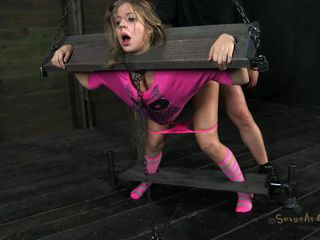 Very hot cheerleader Chastity wearing pink clothes has her head and hands tied up together, being unable to move. Likewise her feet are tied up. One horny guy Matt comes and slides his hard dong into her wet cunt, making her moan with pleasure. The bitch likes to stay still and be drilled so hard from behind!