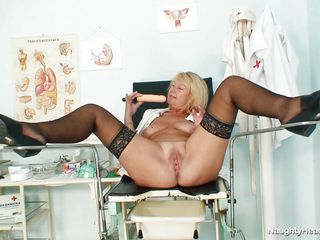 This granny nurse is lying on medical bed and this babe desire to play with her sexy pussy at work. That babe have big and round boobs and a bald and big vagina. The golden-haired nurse have a long dildo and this babe introduce it very unfathomable in the fur pie because this babe desire to have a great orgasm.