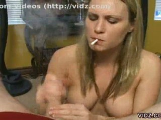 This blond babe just can't quit the habit of smoking. Even during the time that this babe sucks on this man's cock, this babe still has a lit cigarette on her fingers. Watch her suck and spit on that dick for lubrication and watch her stroking it with one