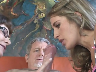 Mature lady is teaching her cub how adjacent to suck a big unearth befitting