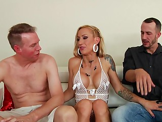 Two men are making out a sweltering milf close to her cunt and close to the ass