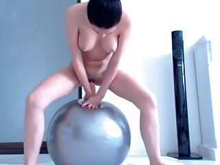 Riding ramrod on exercise ball til this pamper squirts