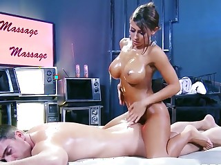 Busty tanned sunless Madison Ivy gives Toni Ribas a massage
