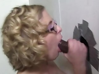 Dick sucking slut fucked at gloryhole